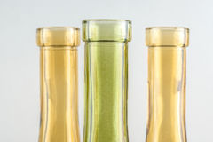 Bright decorative bottles. Bright multicolored decorative bottles on a monophonic background Stock Photography
