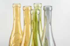 Bright decorative bottles. Bright multicolored decorative bottles on a monophonic background Royalty Free Stock Photo
