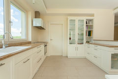 Bright delicate kitchen. Bright and delicate kitchen in modern house Stock Photography