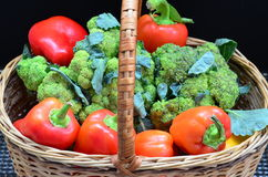 Bright delicious vegetables in a basket. Bright green broccoli, red bell pepper in a basket Royalty Free Stock Photography