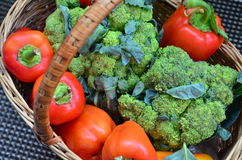 Bright delicious vegetables in a basket. Bright green broccoli, red bell pepper in a basket Stock Photography