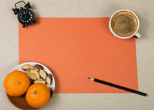 Bright desk top with cup of coffee and healthy snack Royalty Free Stock Images