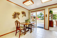 Bright dining area with walkout deck Stock Photography