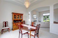 Bright dining room with carved wood cabinet Stock Photos