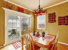 Bright dining room interior in red colors Stock Images