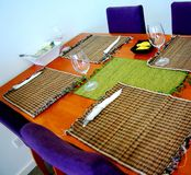 Bright Dining Table. A modern dining table set for dinner (Australia Stock Image