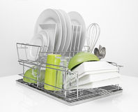 Bright Dishes Drying On Metal Dish Rack Stock Photography