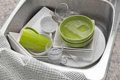 Bright dishes in the kitchen sink Stock Photos