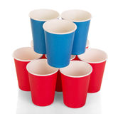 Bright disposable paper cups isolated on white. Stock Photos