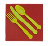 Bright disposable plastic cutlery, knife fork and s. Unusual colour choice! Bright yellow green and red Stock Photo