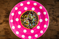 Bright donut on the plate Royalty Free Stock Photography