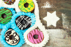 Bright donuts on wooden background royalty free stock photography