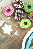 Bright donuts on wooden background royalty free stock images