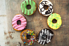 Bright donuts on wooden background stock photo