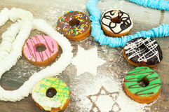 Bright donuts on wooden background stock photos