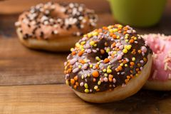 Bright donuts on wooden background. stock photography