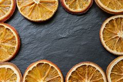 Bright dried orange slices on a stone textured background, copy space, flat lay, top view stock photos
