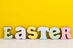 Bright Easter background.  Decoration eggs and colorful letters forming words  EASTER. Celebration concept. Studio Photo royalty free stock photo