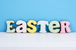 Bright Easter background.  Decoration eggs and colorful letters forming words  EASTER. Celebration concept. Studio Photo stock photos