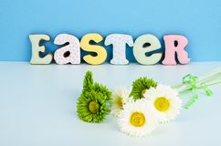 Bright Easter background.  Decoration eggs and colorful letters forming words  EASTER. Celebration concept. Studio Photo royalty free stock images