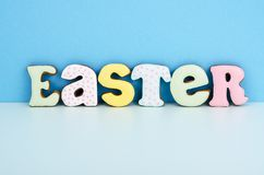 Bright Easter background.  Decoration eggs and colorful letters forming words  EASTER. Celebration concept. Studio Photo royalty free stock image
