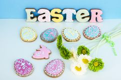 Bright Easter background.  Decoration eggs and colorful letters forming words  EASTER. Celebration concept. Studio Photo stock image
