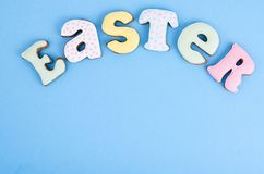 Bright Easter background.  Decoration eggs and colorful letters forming words  EASTER. Celebration concept. Studio Photo stock photography