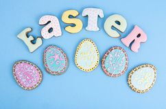 Bright Easter background.  Decoration eggs and colorful letters forming words  EASTER. Celebration concept. Studio Photo royalty free stock photos