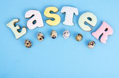 Bright Easter background.  Decoration eggs and colorful letters forming words  EASTER. Celebration concept. Studio Photo stock photo