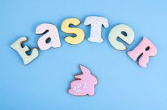 Bright Easter background.  Decoration eggs and colorful letters forming words  EASTER. Celebration concept. Studio Photo royalty free stock photography