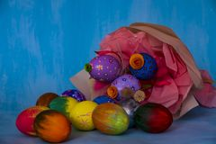 A bright Easter composition consisting of hand-painted eggs royalty free stock images