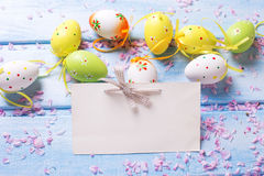 Bright Easter eggs  and empty tag Stock Photography