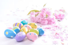 Bright Easter eggs with pink flowers on white background Royalty Free Stock Photo