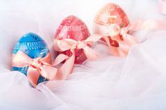 Bright Easter Eggs with Satin Bows Royalty Free Stock Image