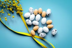 Bright easter set with eggs on blue background top view mock-up. Bright easter set with eggs and flower for cards on blue background top view mock-up Stock Images