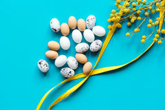Bright easter set with eggs on blue background top view mock-up. Bright easter set with eggs and flower for cards on blue background top view mock-up Stock Photography