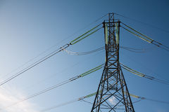 Bright electrial tower. Energy transmission from power plant to customers Royalty Free Stock Photos