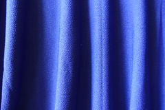 Bright electric blue fabric with vertical pleats Stock Photos