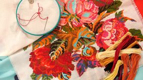 Bright embroidery with flowers, flosses thread and stock video footage