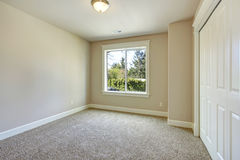 Bright Empty Room With One Window Carpet Floor And Ivory Walls
