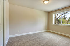 Bright empty bedroom Stock Images