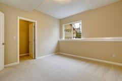 Bright empty bedroom in light ivory tone Stock Photos