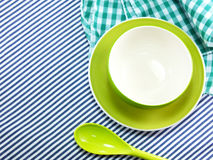 Bright empty bowls Ceramic cups and plastic spoons on table cloth Stock Photos