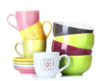 Bright empty bowls, cups and plates Stock Photo