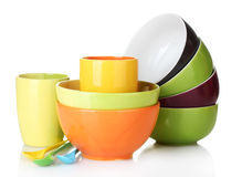 Bright empty bowls, cups and spoons Stock Photos