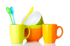 Bright empty bowls, cups and spoons Stock Images