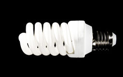 Bright energy saving fluorescent light bulb Royalty Free Stock Images