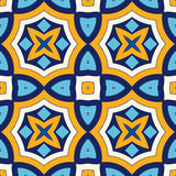 Bright ethnic abstract background. Seamless pattern with symmetric geometric ornament. Ornamental mosaic texture. Vector illustration Stock Photo