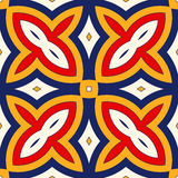 Bright ethnic abstract background. Seamless pattern with symmetric geometric ornament. Royalty Free Stock Photo