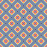 Bright ethnic abstract background. Seamless pattern with symmetric geometric ornament. Royalty Free Stock Image